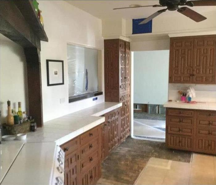 kitchen with damaged floors