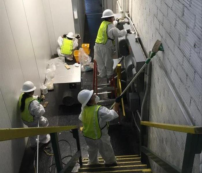 workers cleaning walls
