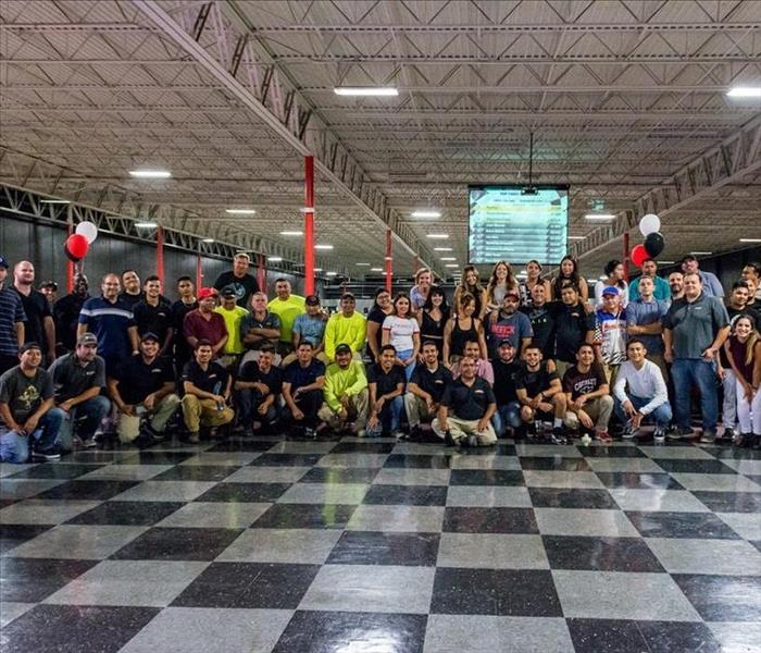 team at indoor race track