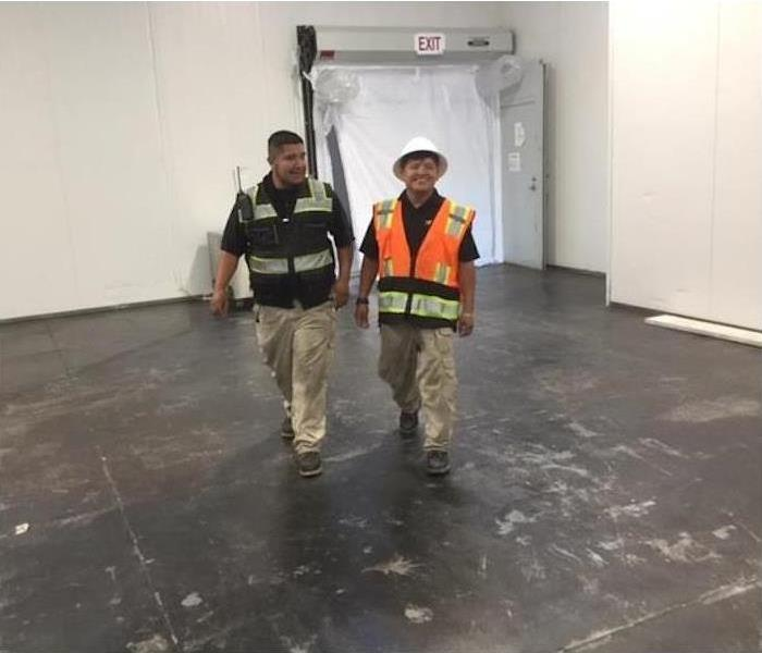 two project managers walking in building